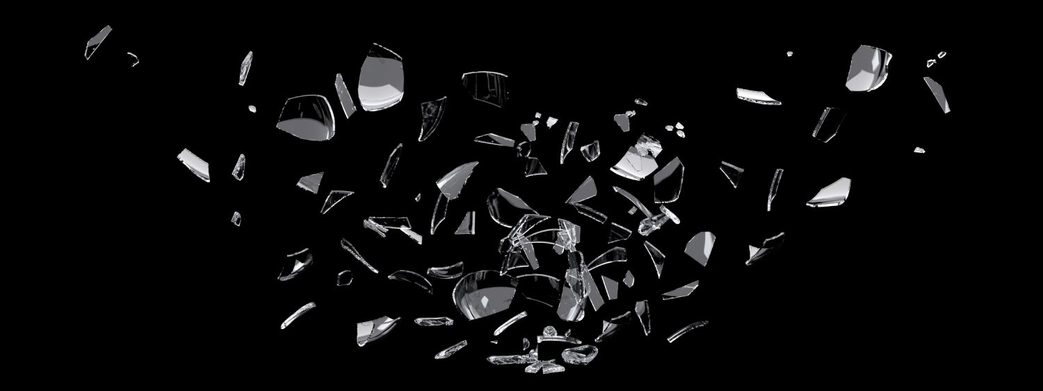 white glass shards scattered across black surface