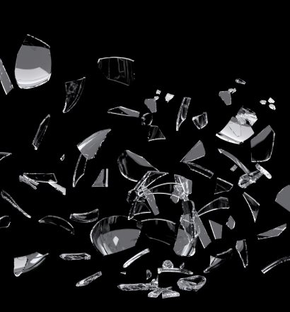 white glass shards scattered across black surface